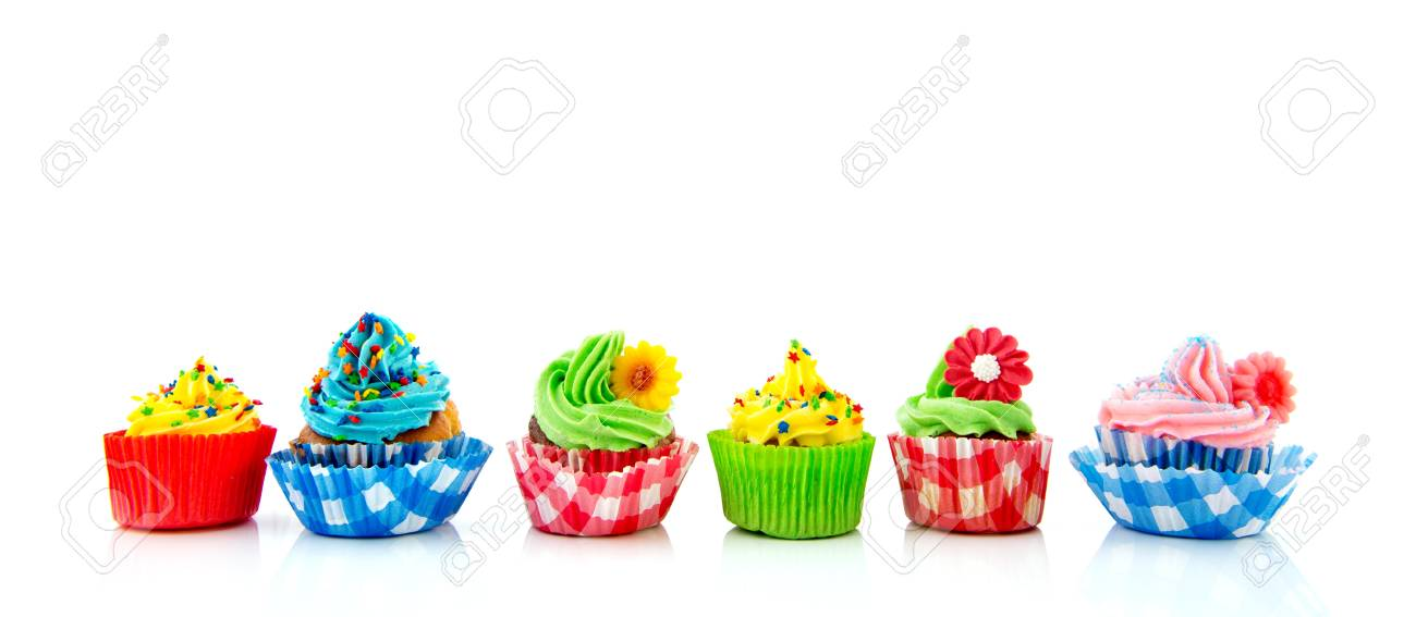 Row with six home made colorful cupcakes with butter cream Stock Photo - 21042359