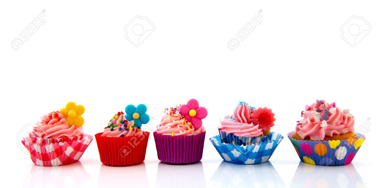 Row with six home made colorful cupcakes with butter cream Stock Photo - 21042361