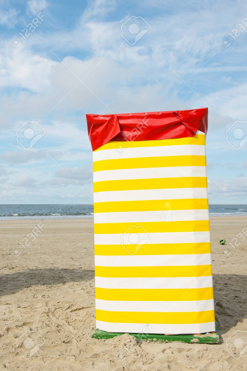 Stock Photo   Typical Yellow Striped Chair At The Beach Of German Wadden  Island Borkum