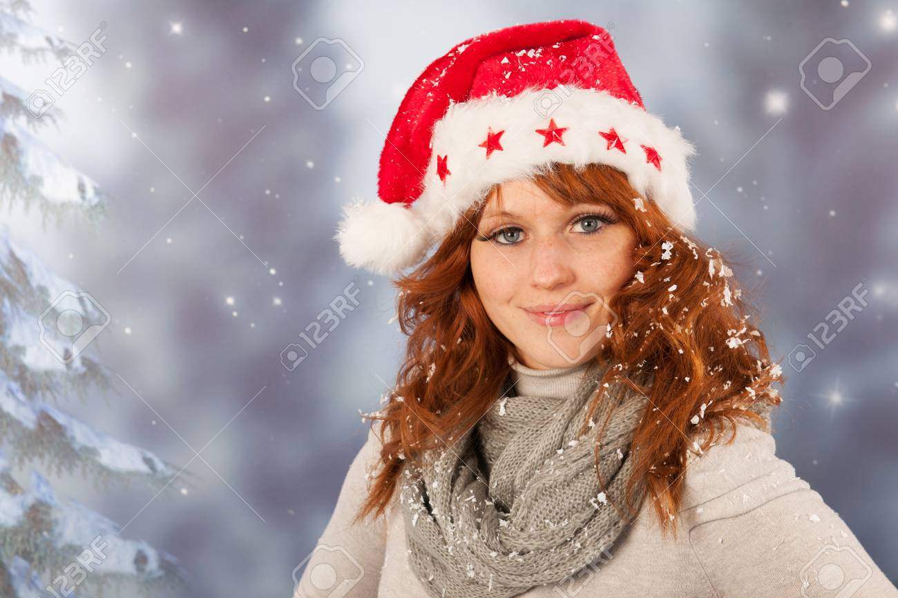 df662530f32e5 Portrait of woman in winter with snow and hat of Santa Claus Stock Photo -  23960961