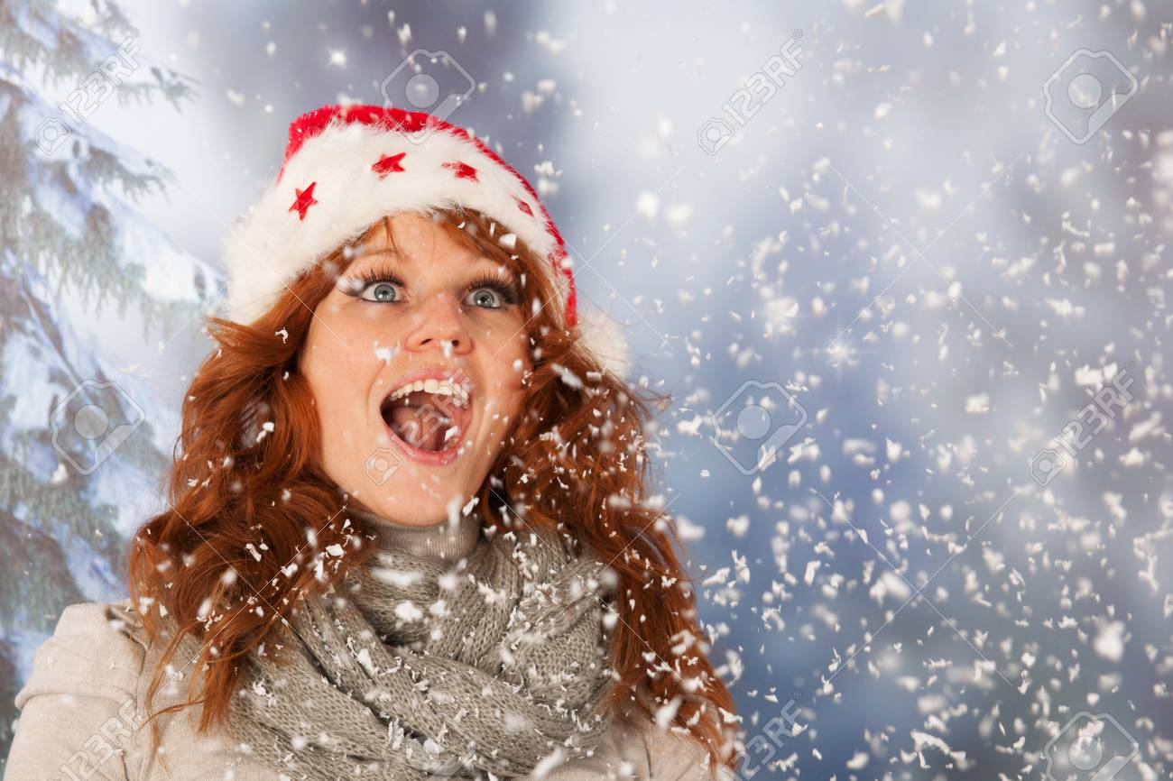 2f0d802b02ddf Portrait of woman in winter with snow and hat from Santa Claus Stock Photo  - 24130073