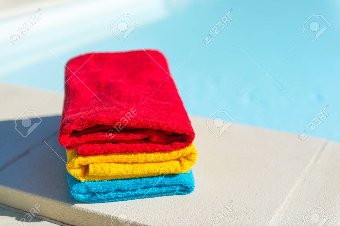 Colorful stacked towels at the swimming pool