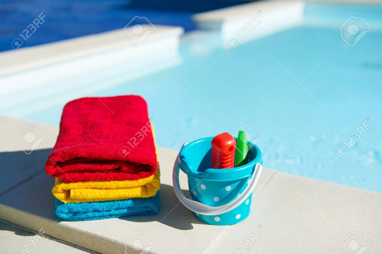 Toys and towels at the swimming pool
