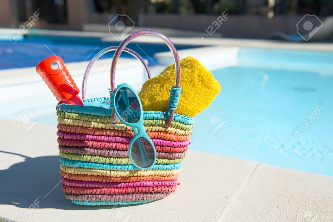 Vacation With Beach Bag And Towels At The Swimming Pool Stock ...