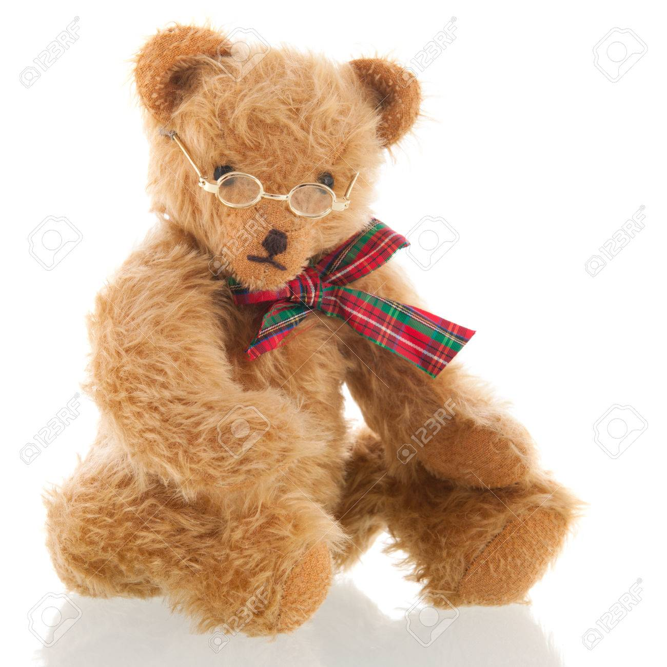 f31f23b1a94 Stock Photo - Stuffed intelligent bear with glasses isolated over white  background
