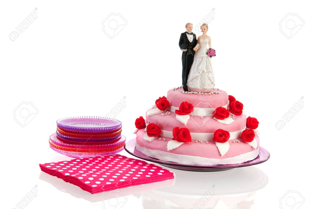 Couple On Top Of Pink Wedding Cake With Red Roses Isolated Over ...