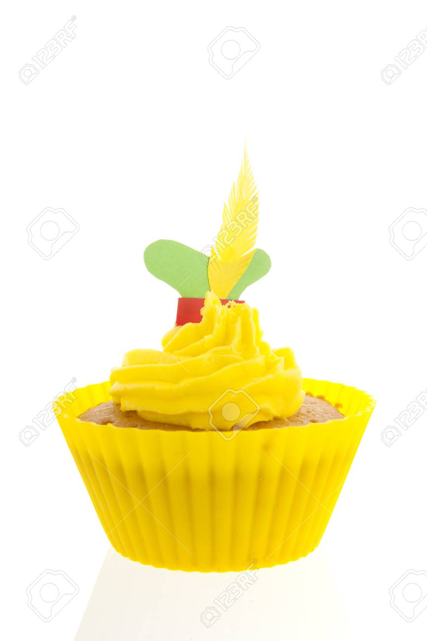 0f4cbc6f47ba3 Dutch Sinterklaas cupcake with hat of Pete in yellow isolated over white  background Stock Photo -