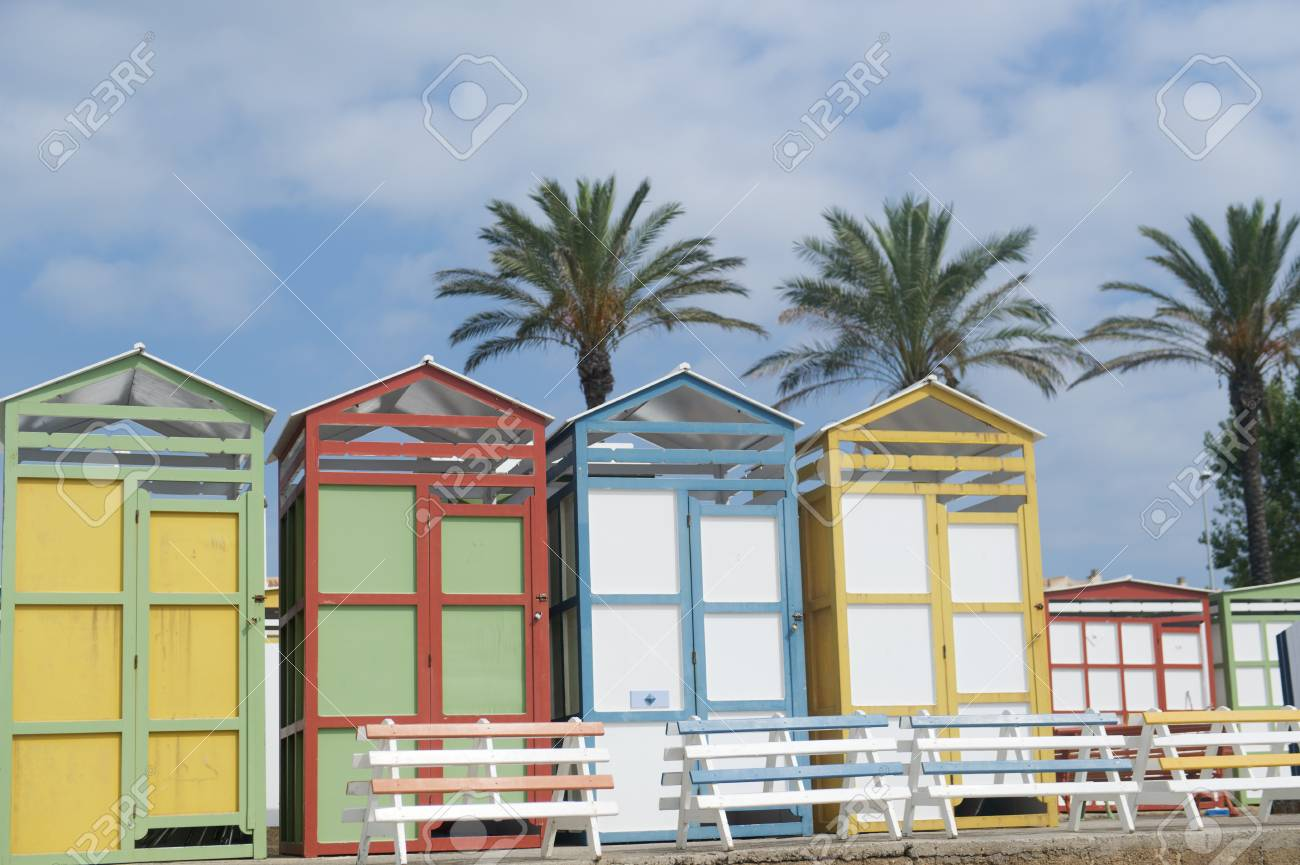 Colorful Wooden Beach Cabins At The Coast