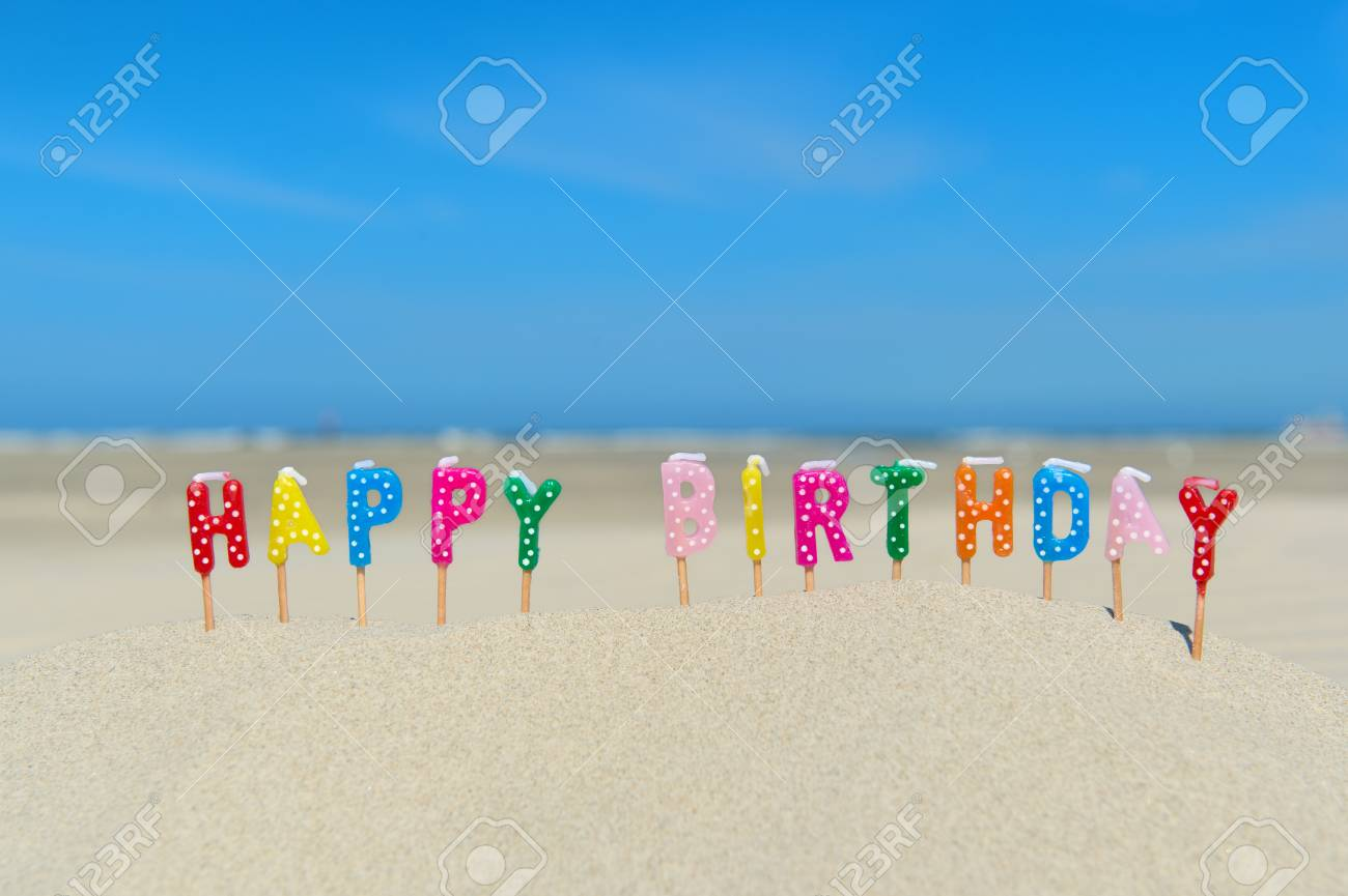 Happy Birthday Candles At The Beach Stock Photo