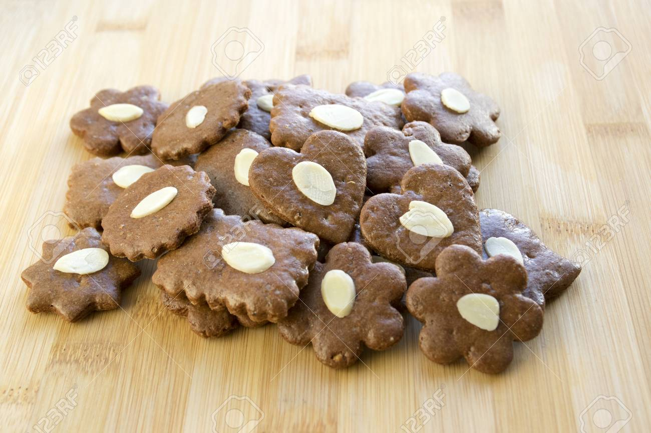 Brown Moravian Dark Gingerbreads With Sliced Almonds On Wooden
