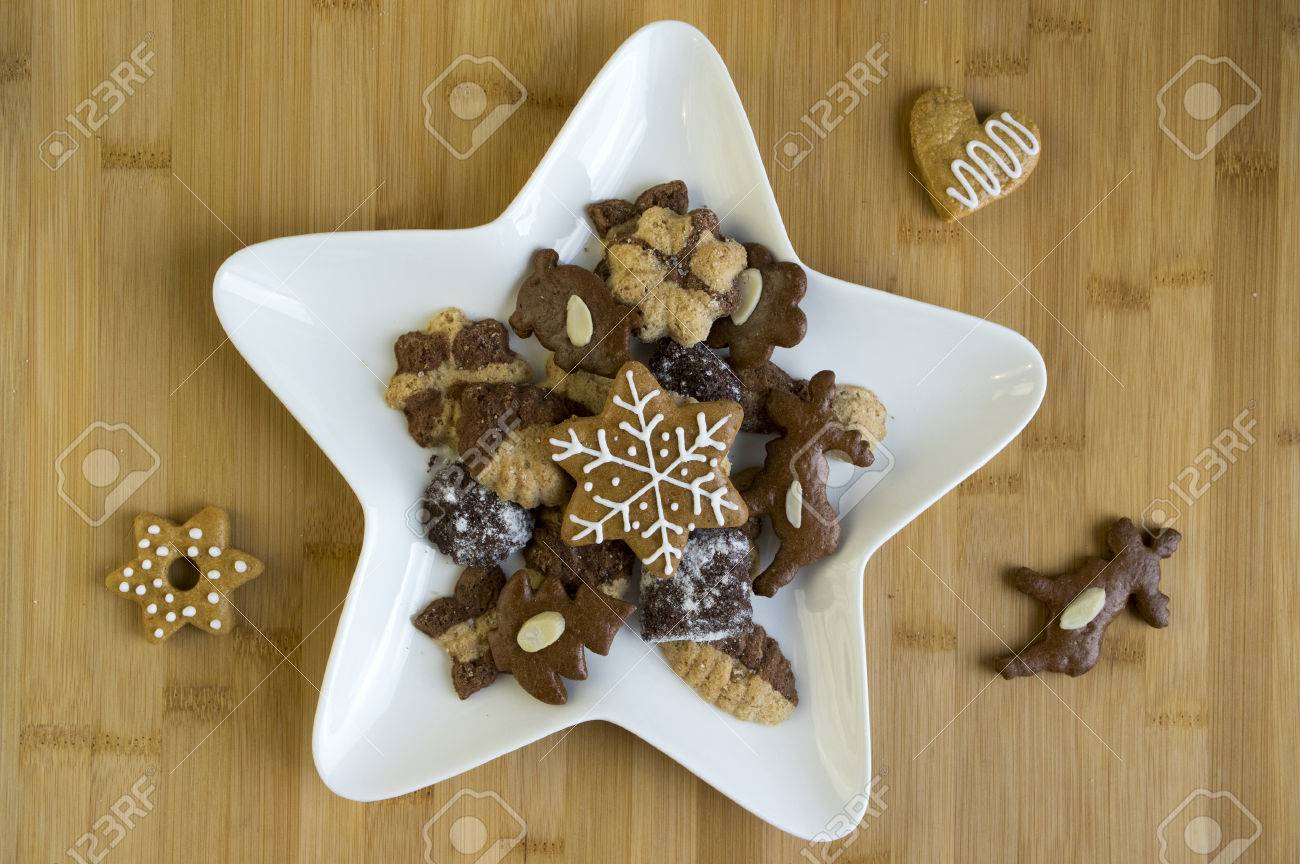 Many Kinds Of Christmas Cookies On White Plate Gingerbread Dark