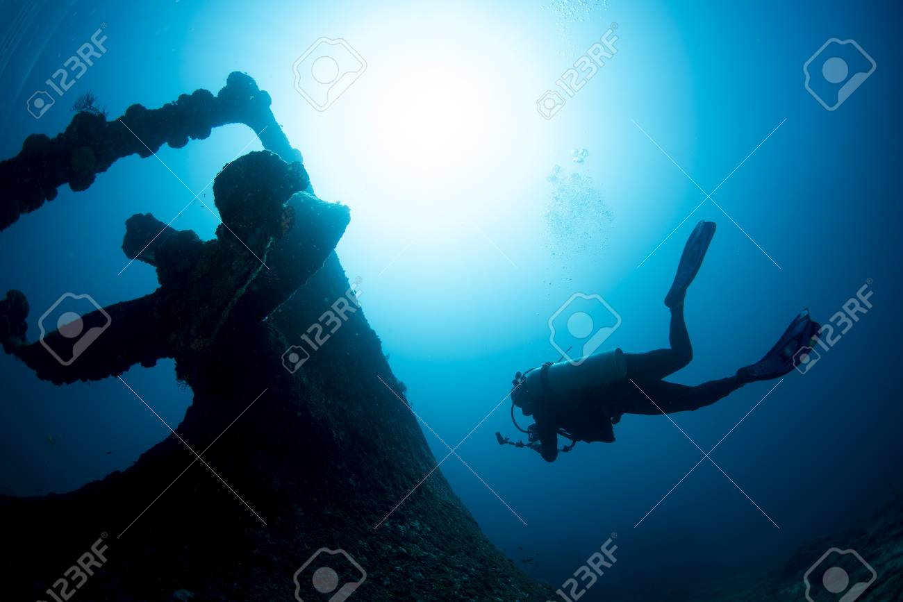 Ship Wreck propeller underwater with scuba diver silhouette while diving - 120356091