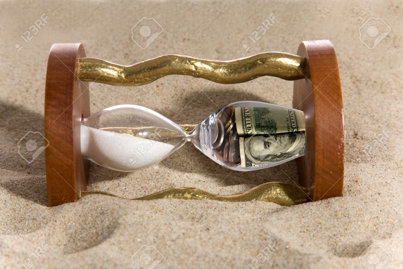 hourglass and financial crisis on sand - 5016525