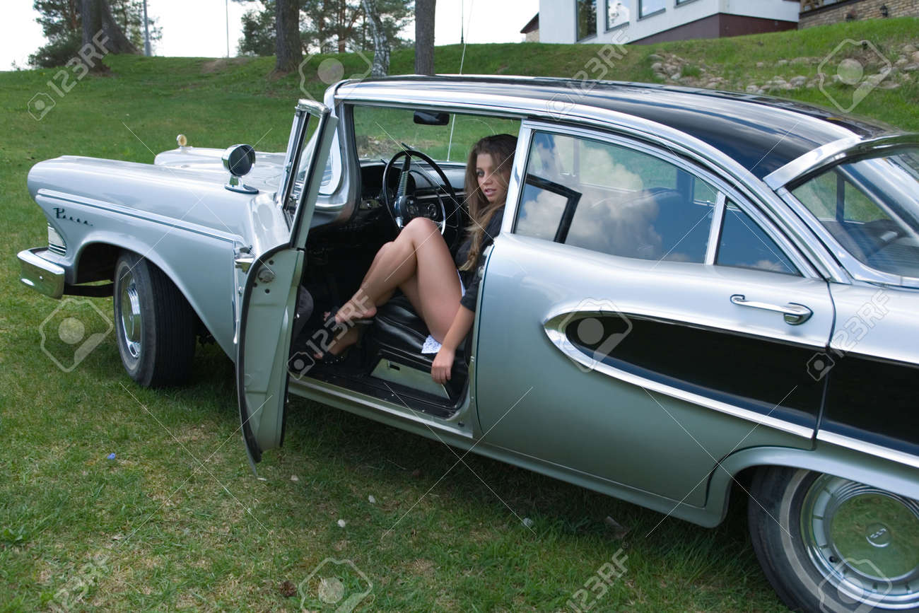 Young Girl In Short Skirt In Old-fashioned Car Stock Photo ...