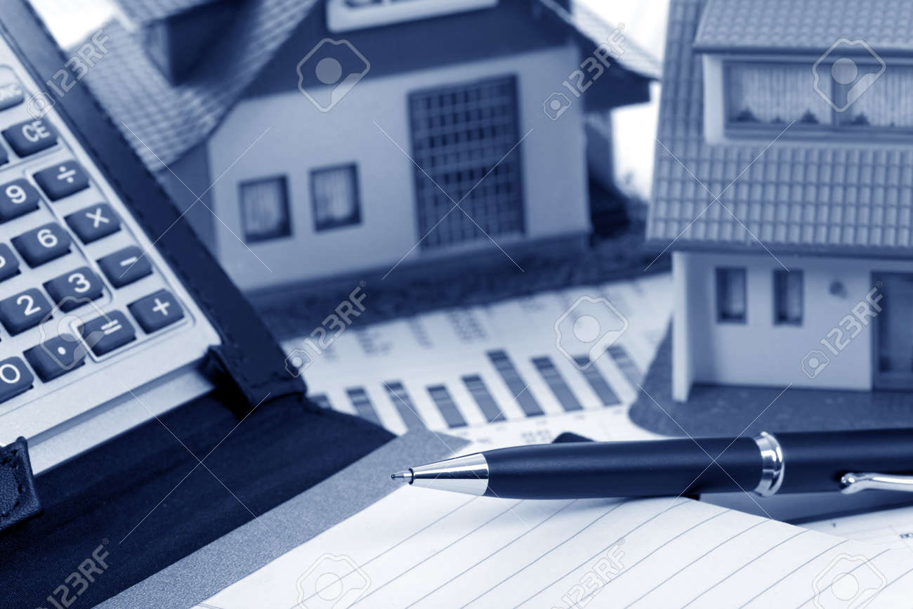 Model house and calculator on construction plan Stock Photo - 6667916