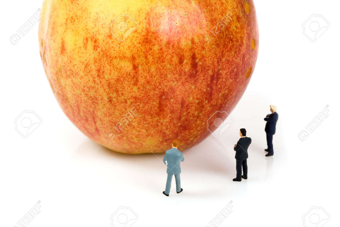 business team with a apple isolated over a white background Stock Photo - 6750381