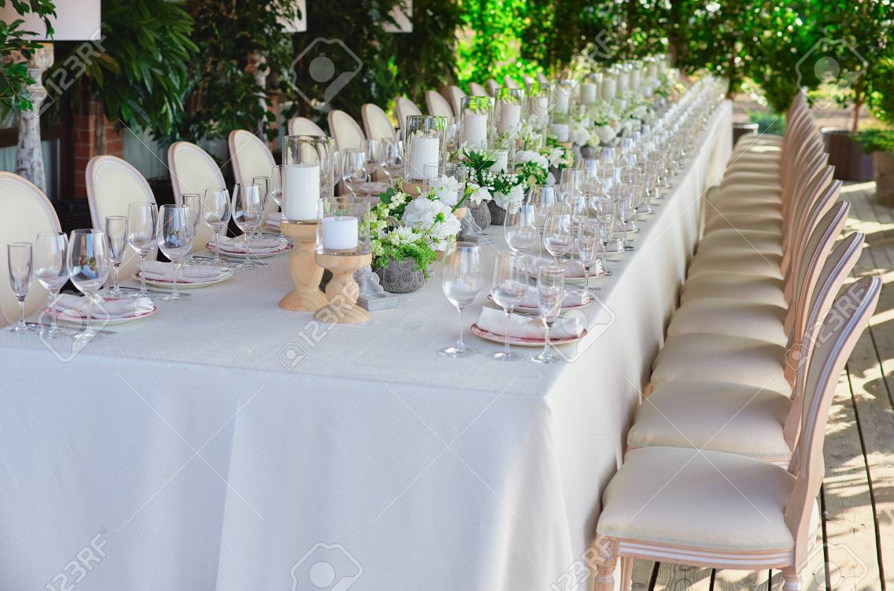 Outdoor wedding celebration at a restaurant. Festive table setting catering. Wedding in rustic & Outdoor Wedding Celebration At A Restaurant. Festive Table Setting ...