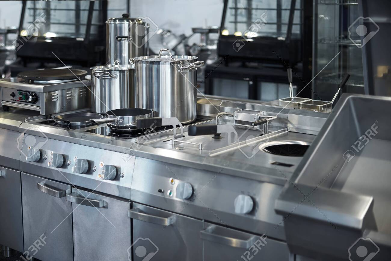 Work surface and kitchen equipment in professional kitchen, view counter in stainless steel . Bokeh . - 128614471