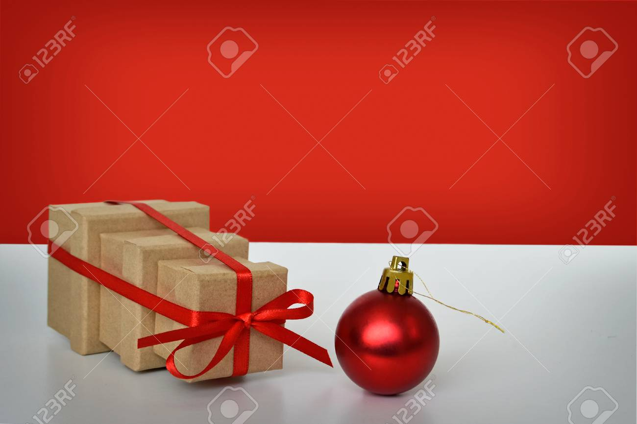 Three Christmas Gift Boxes Tied Together With Red Ribbon And.. Stock ...