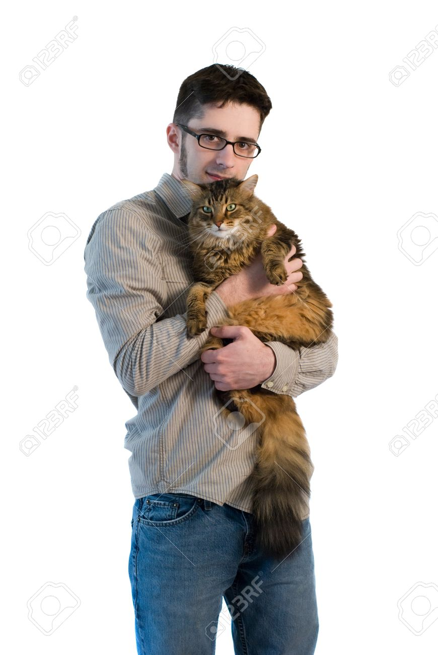 A young adult man on isolated white background holding his big maine coon cat Stock Photo - 8598101