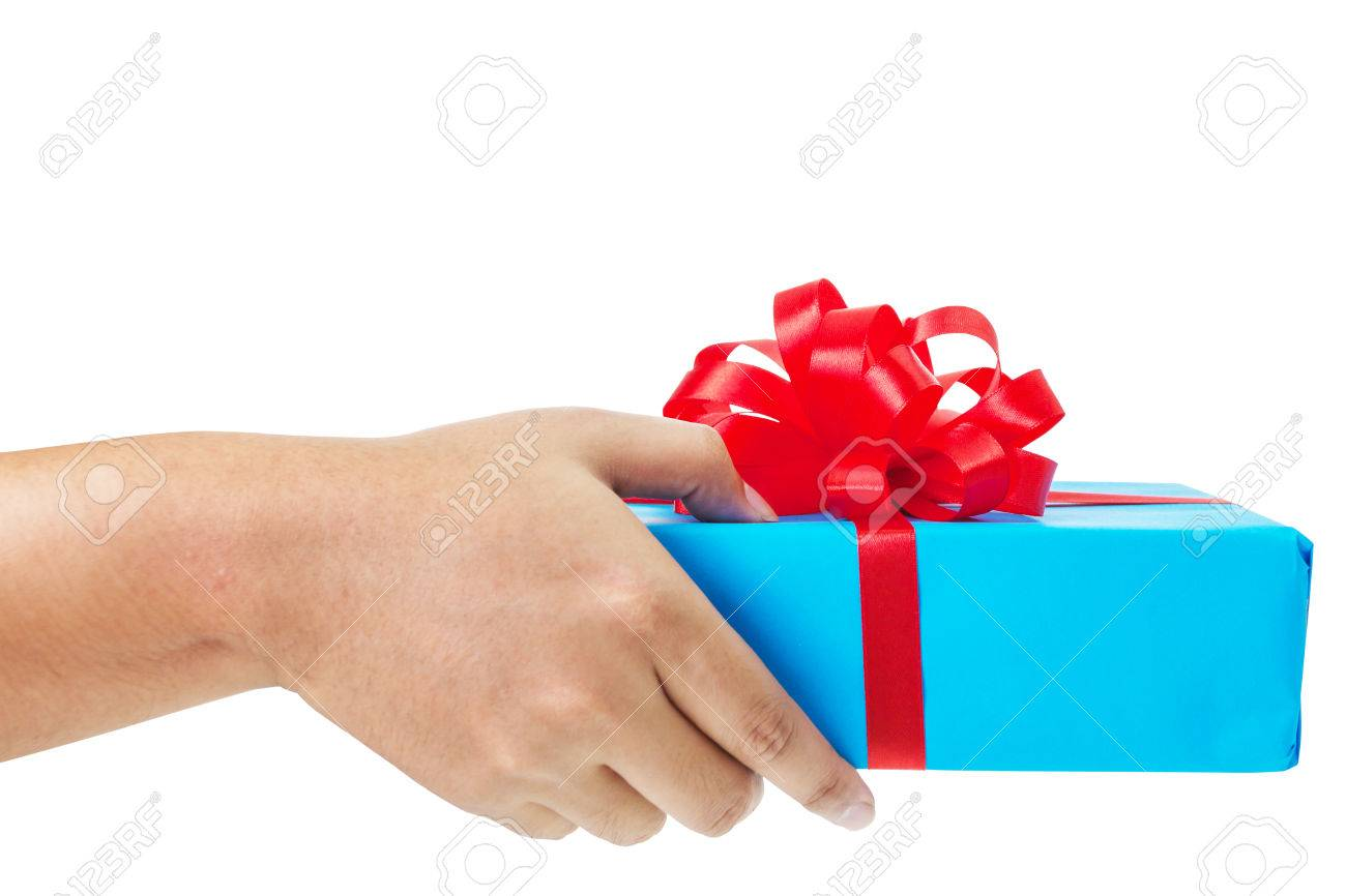 Asian hand giving a gift wrapped in blue box with red ribbon and bow. the most beautiful gift isolated on white background - 49248390