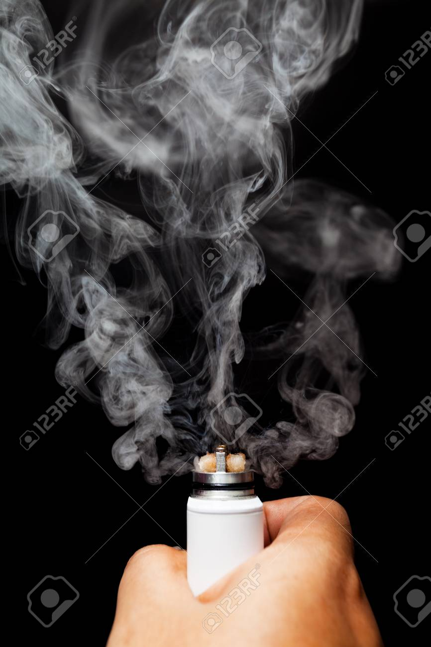 human hand holding rebuild able atomizer electronic cigarette. on black color background. - 51068179