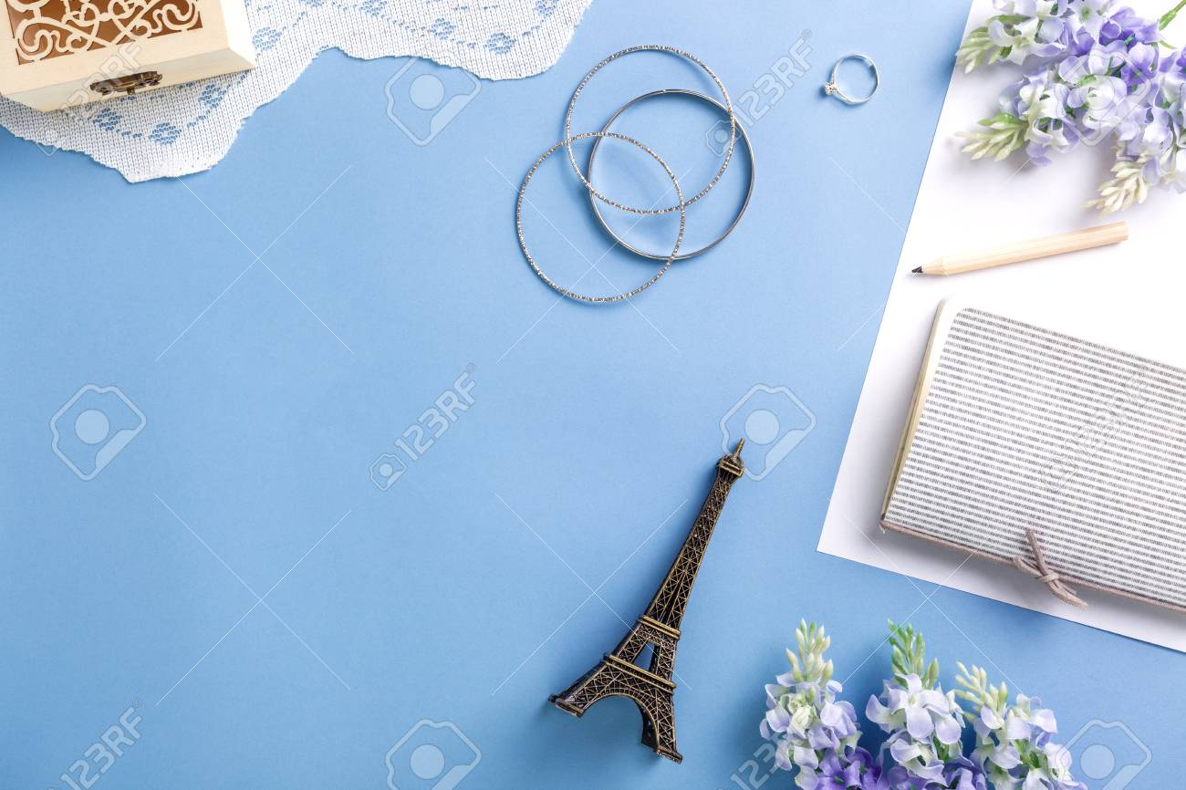 Flat lay of woman accessories on blue background - 105338130