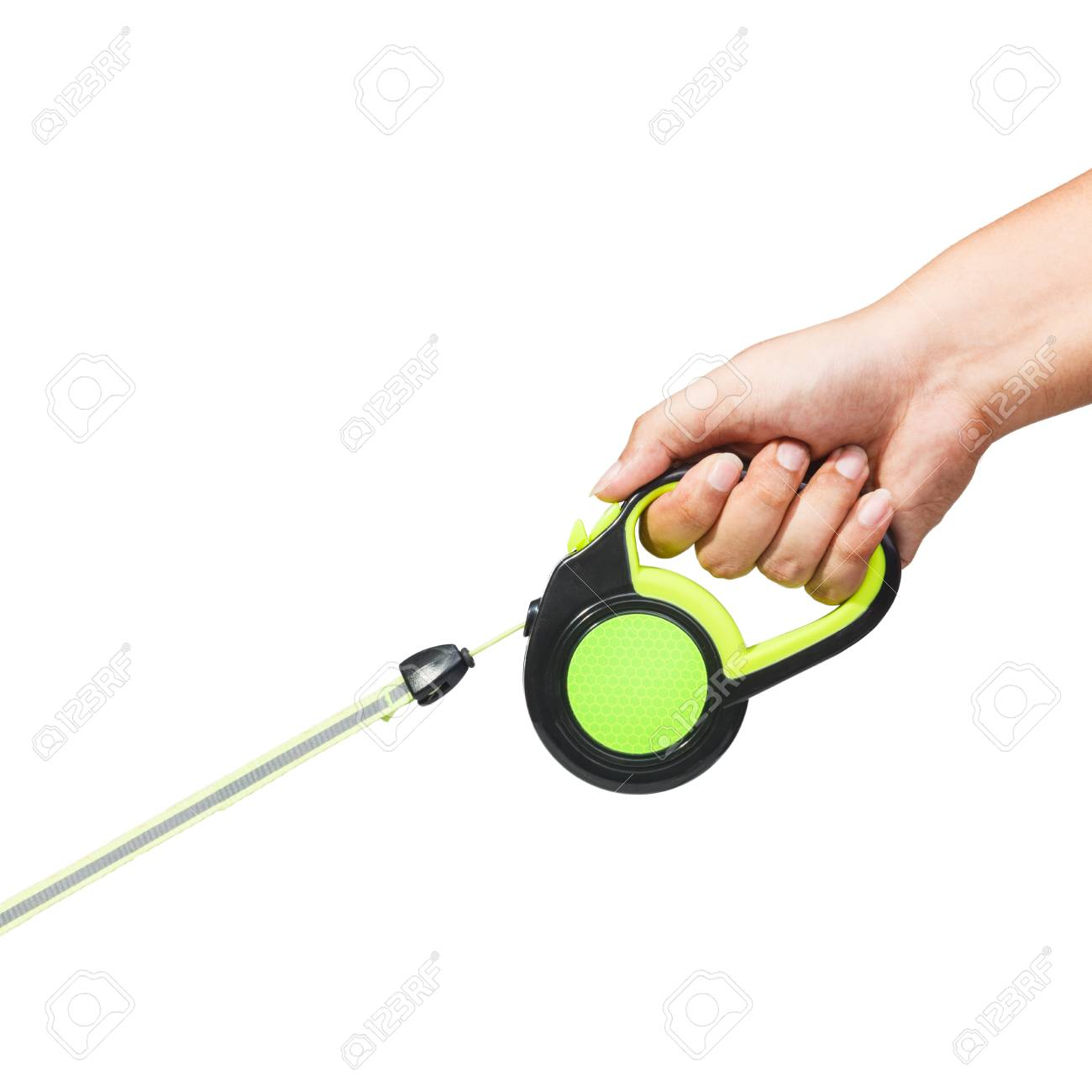 Hand holding black and green retractable dog leash on isolated white background - 104939774