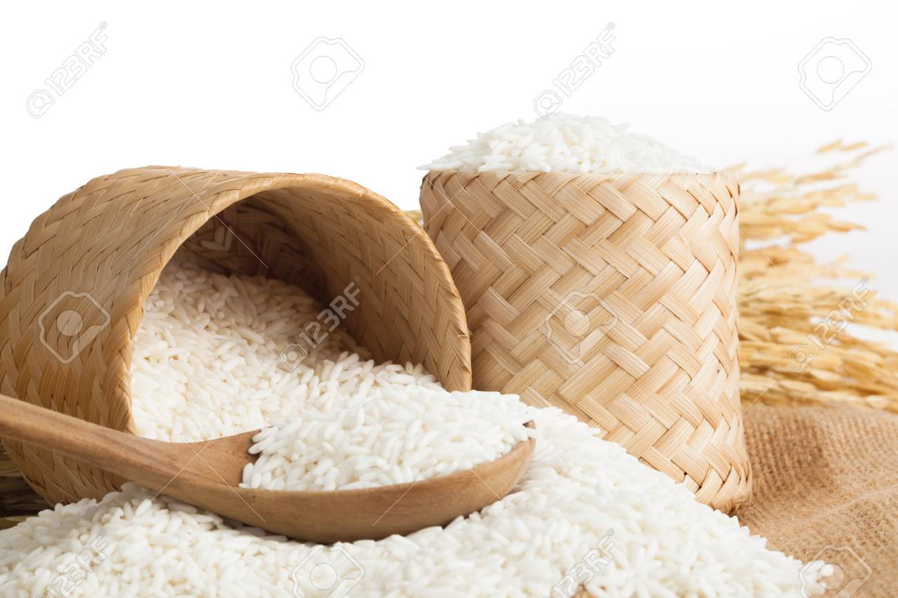 uncooked plain white jasmine rice and wooden spoon. Close up on the table. Horizontal - 104939797