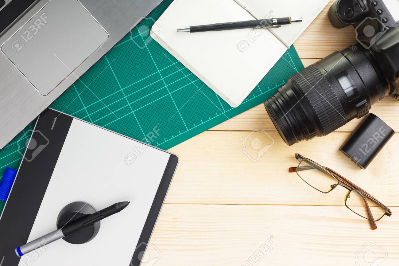 Top view of office stuff and gadgets on wooden desk with graphic designer equipment. flat lay style. - 106197683