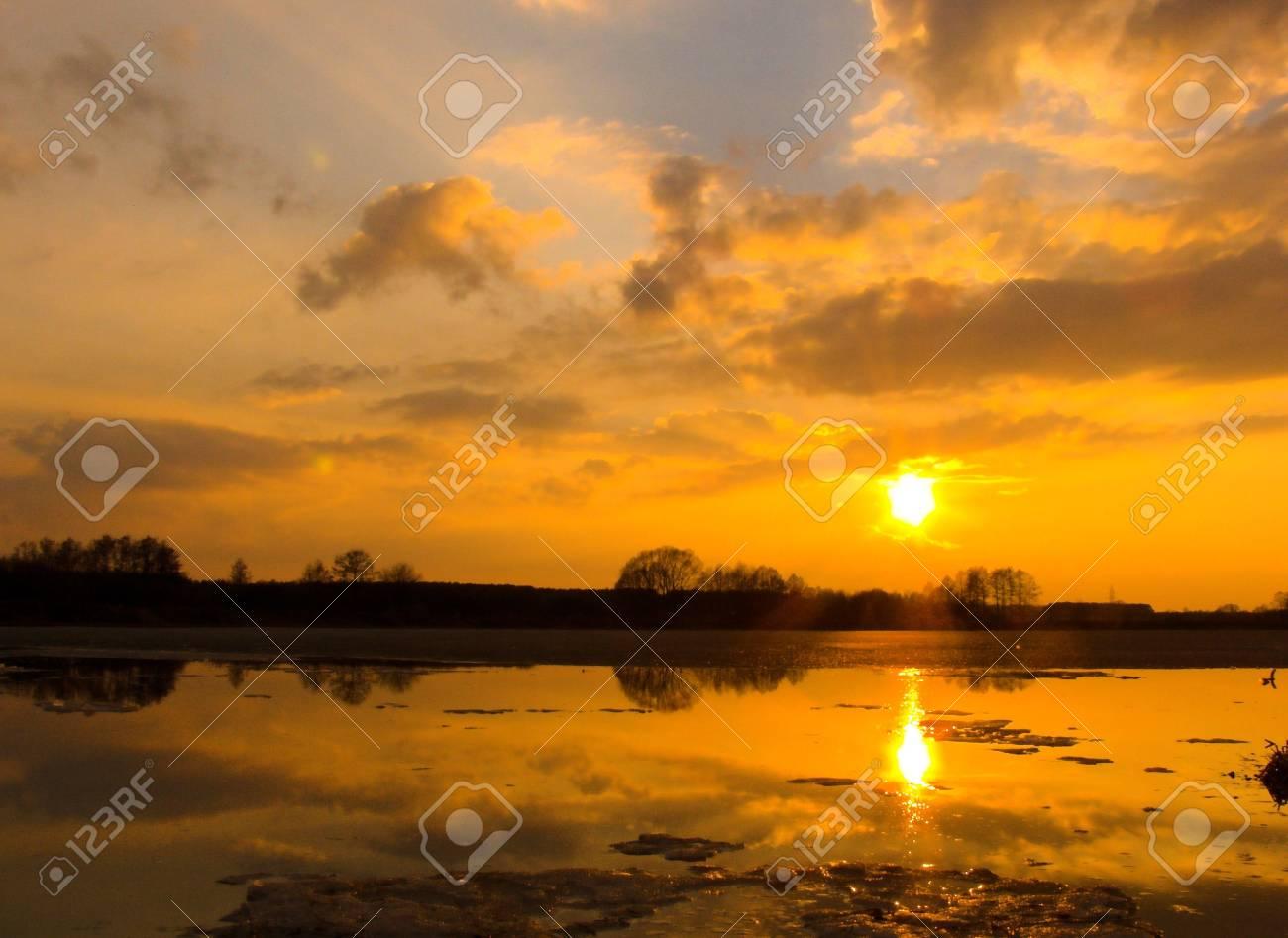 Sunset by a lake Stock Photo - 371386