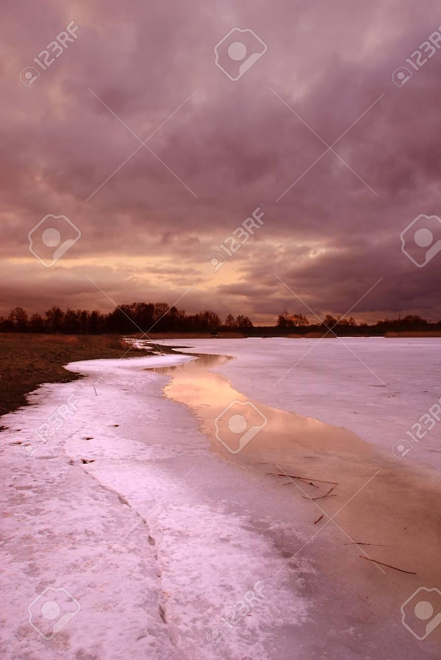 Sunset by a frozen lake Stock Photo - 789680