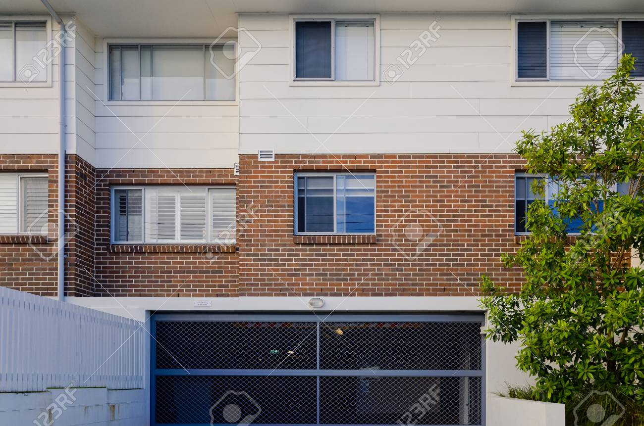 Modern residential apartment building exterior with windows and..