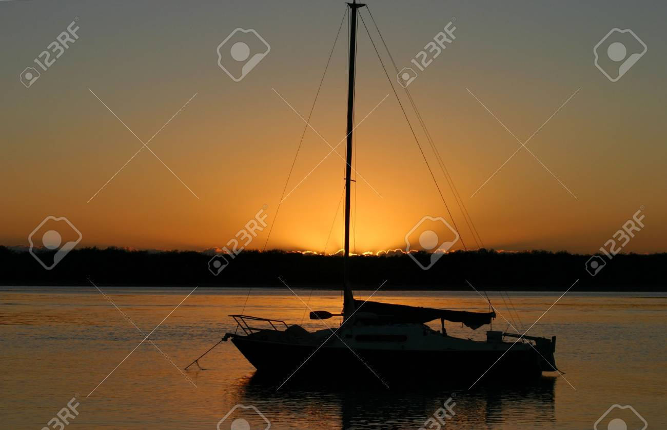 Yacht bathed in the early moring dawn light. Stock Photo - 1787332