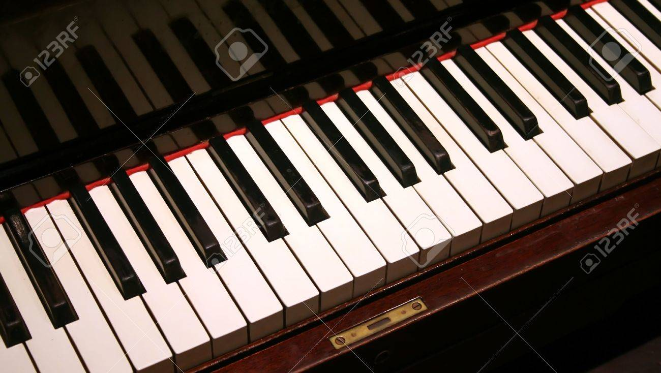 Piano keys on an old fashioned upright piano keyboard. Stock Photo - 2475201