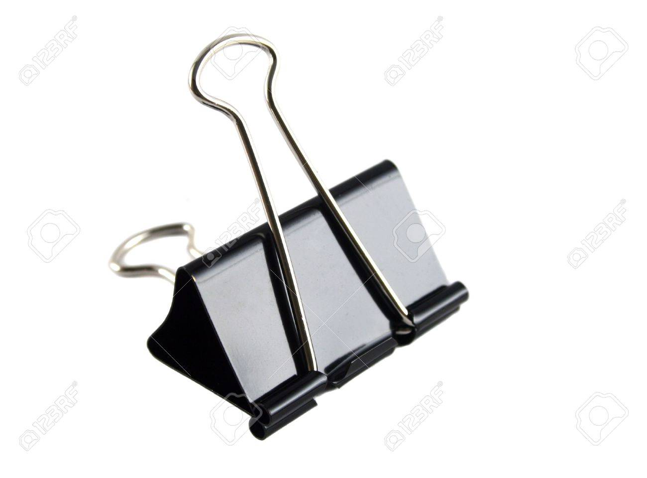 Steel foldback clip used for clipping sheets of paper together. Stock Photo - 2529615