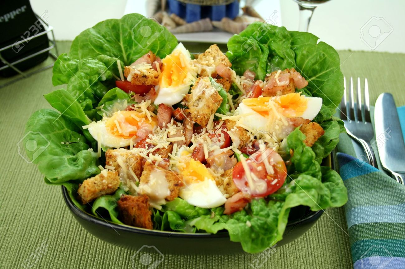 Fresh Caesar salad with lettuce, cherry tomatoes, parmesan cheese, egg, bacon and croutons. Stock Photo - 3522425