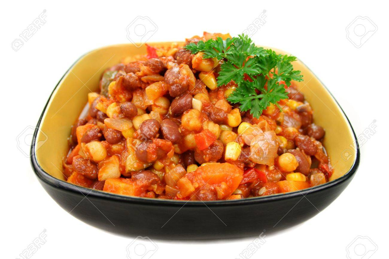 Delicious vegetable and lentil hot pot with a parsley garnish ready to serve. Stock Photo - 3639172