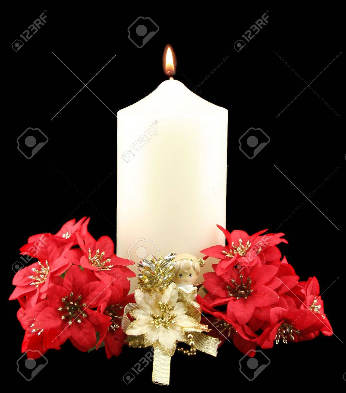 Christmas church candle with angel and red flowres. Stock Photo - 3768088