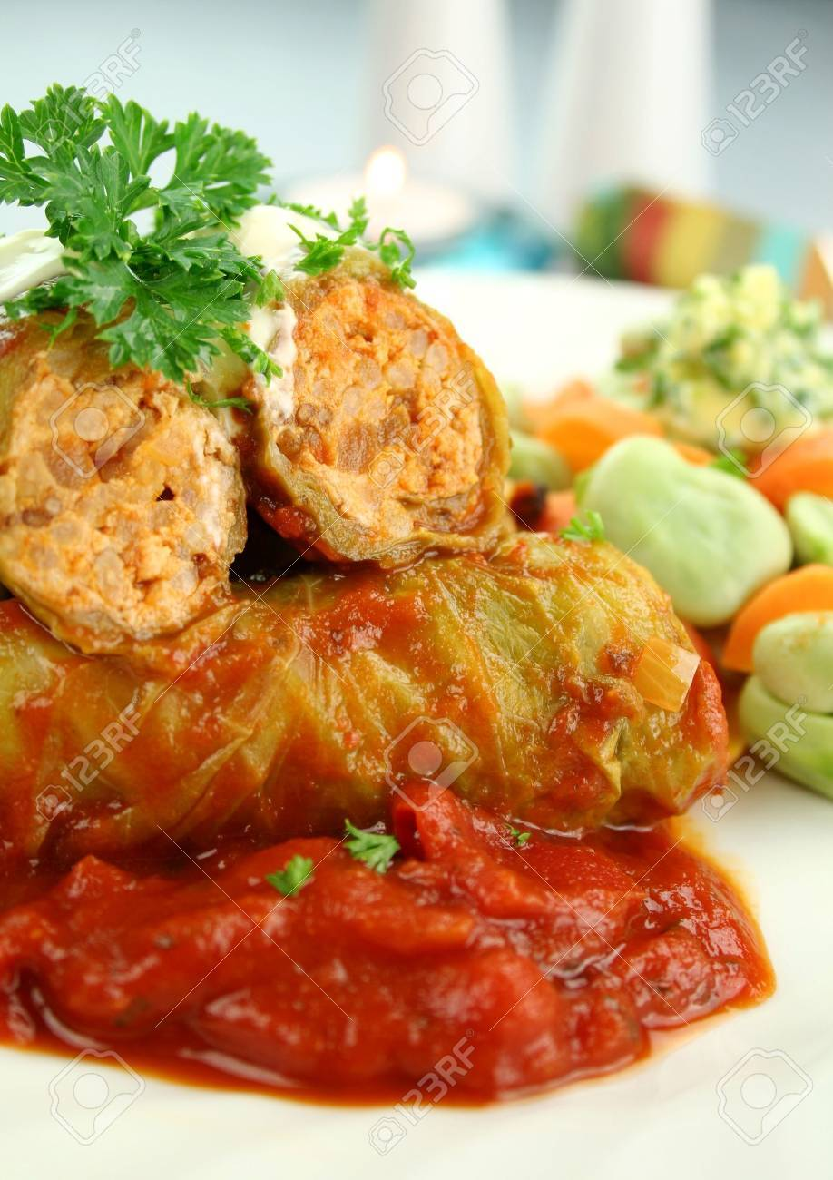 Baked cabbage rolls with carrots and broad beans with a tomato sauce. - 4546964