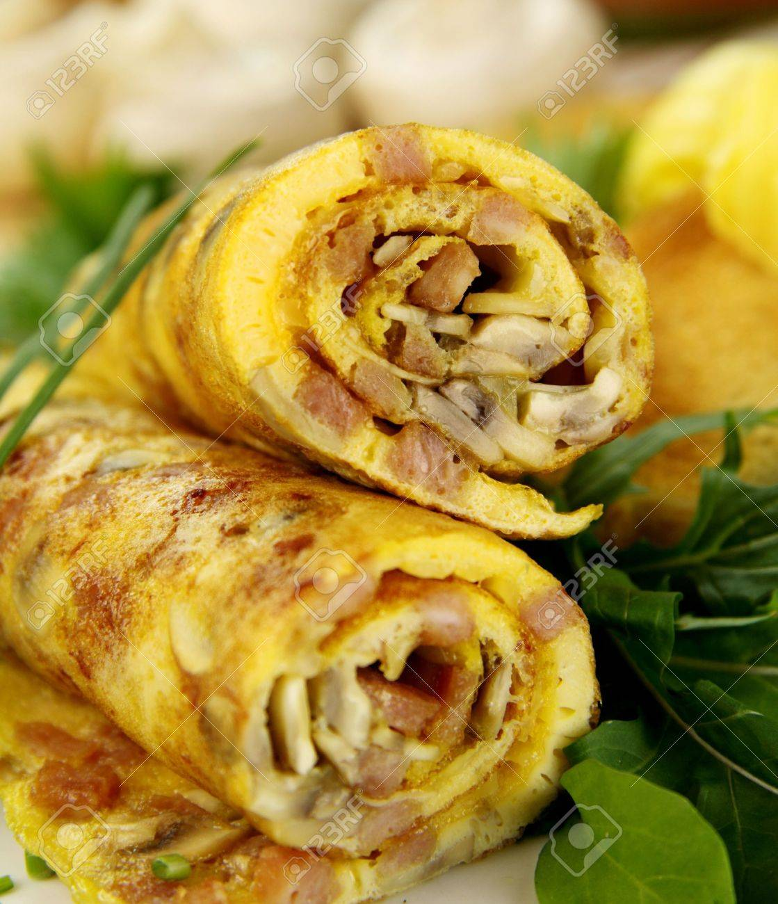 Delicious rolled mushroom and bacon omelette freshly prepared and ready to serve. - 5067759