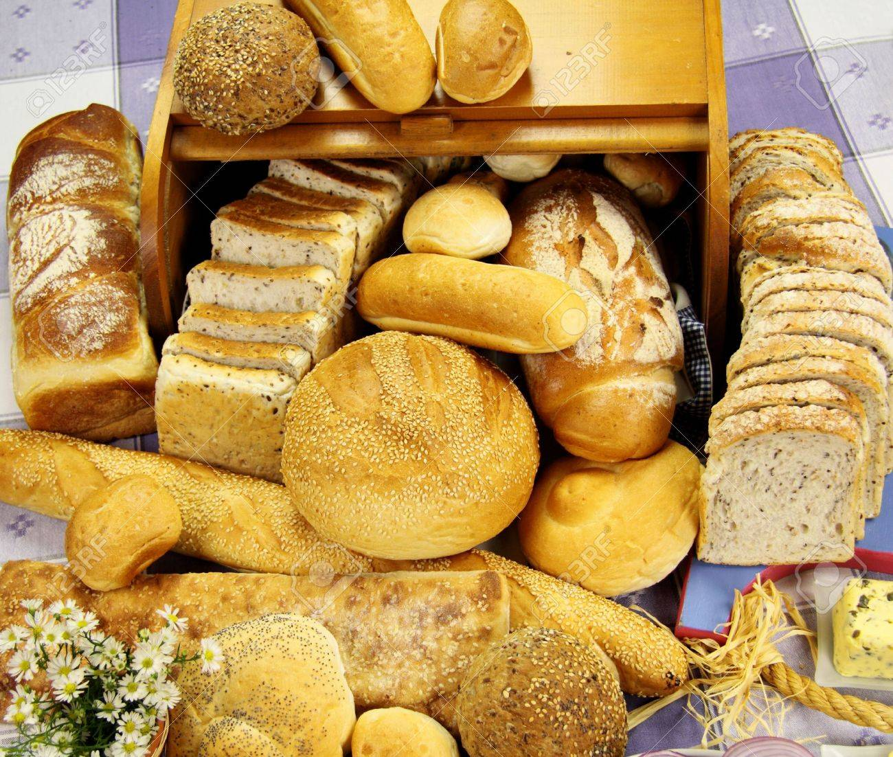 Selection Of Different Types Rolls Loaves And Bread Sticks Stock Photo