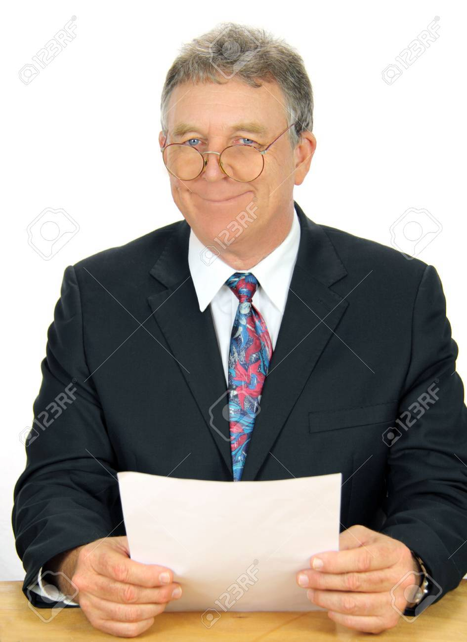 Geeky business executive smiles looking over his old fashioned glasses. Stock Photo - 5295030