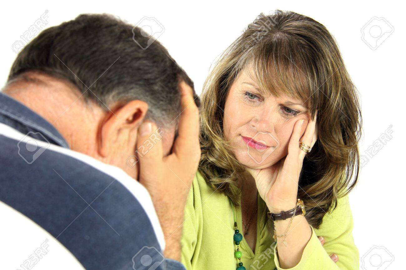 Upset and emotional middle aged couple after an argument. - 5406967