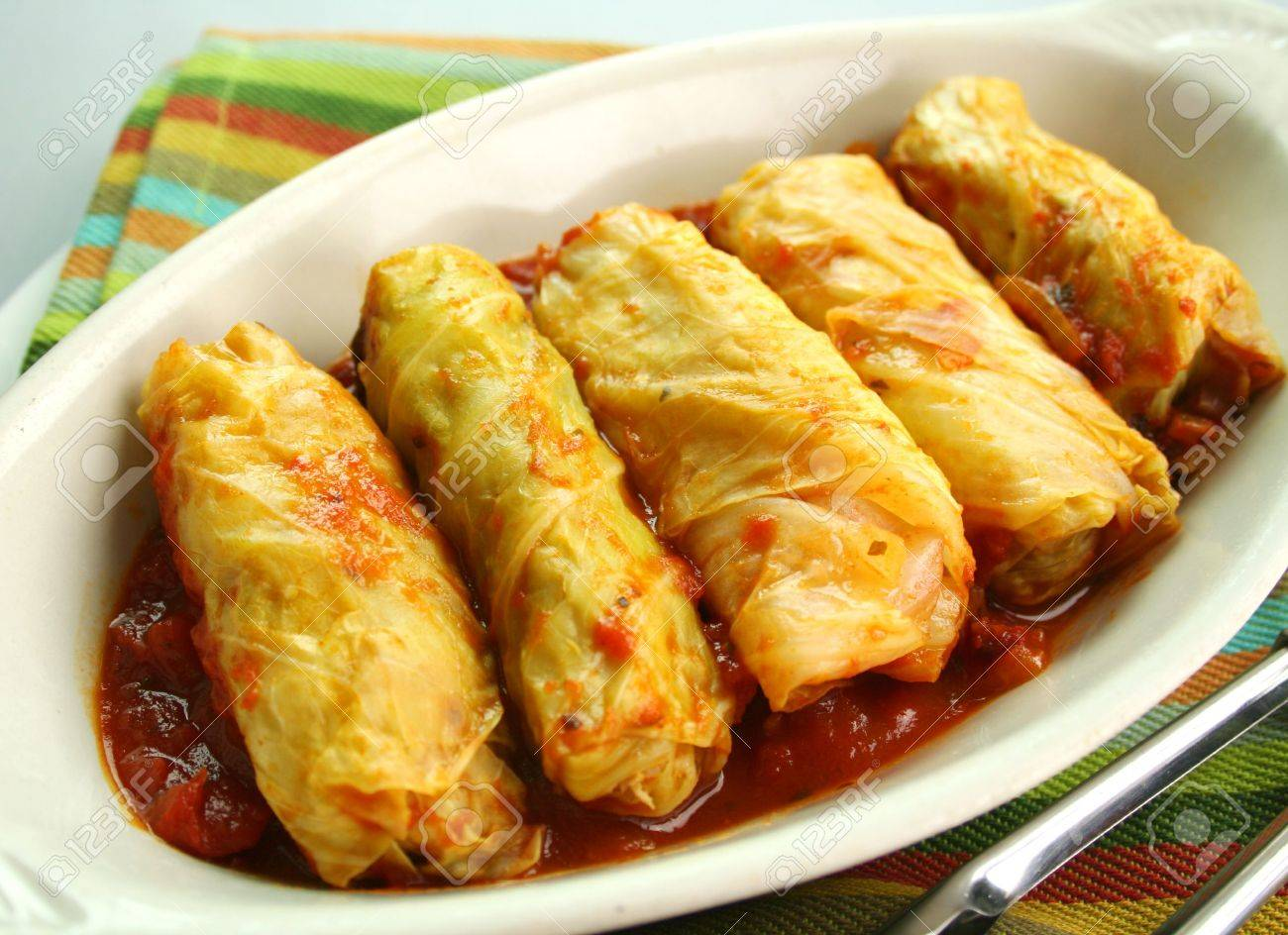 Piping hot baked cabbage rolls with a tomato sauce ready to serve. - 6120021
