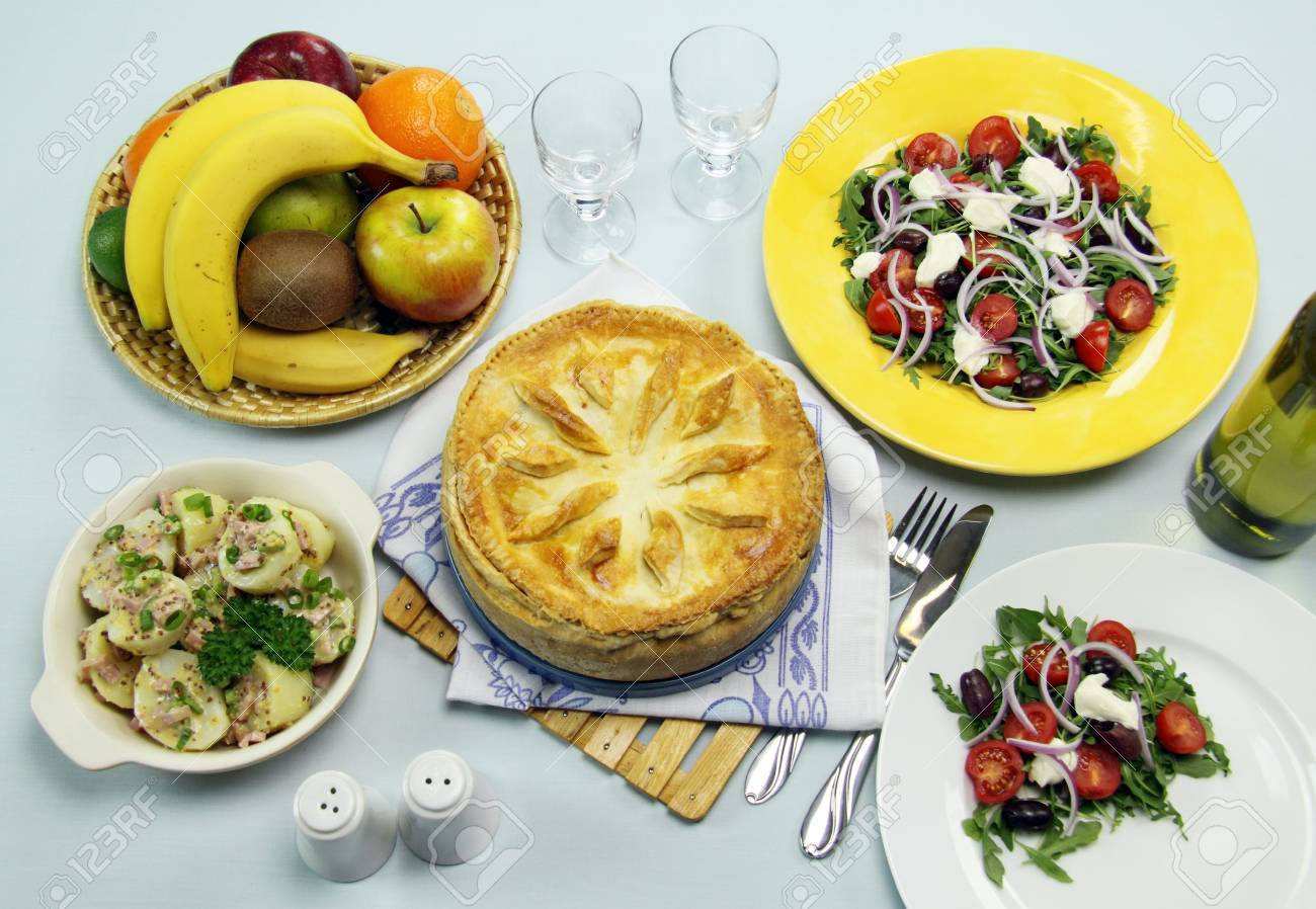 Delicious baked ham and egg pie with potato and salad ready to serve. Stock Photo - 6253402