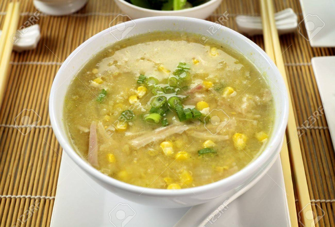 Delicious Chinese chicken and corn soup ready to serve. - 7354226