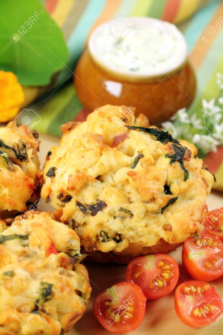 Fresh baked savory muffins with herb spread and cherry tomatoes. - 8062616