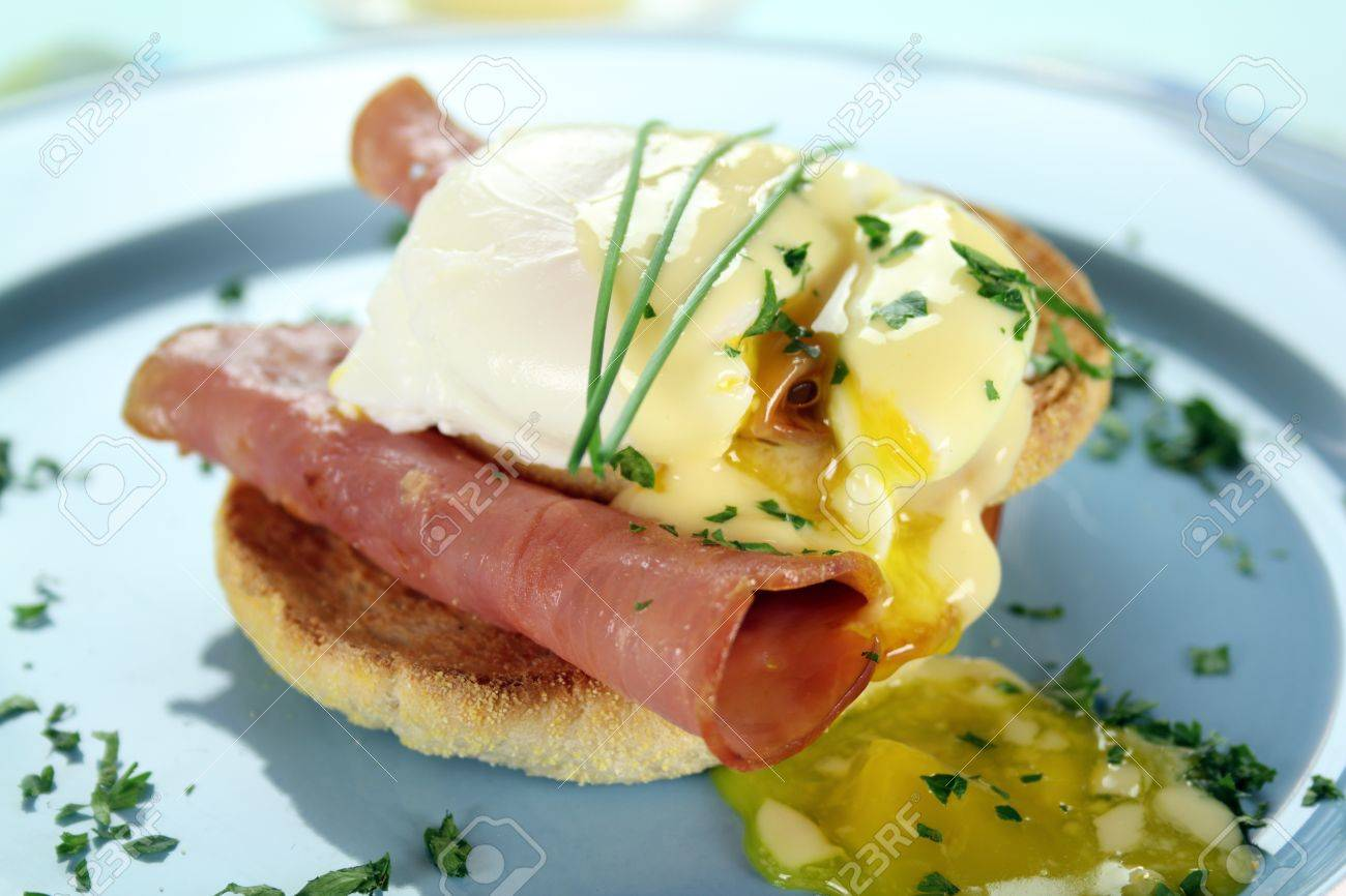 Delicious breakfast of eggs benedict with beautiful rich hollandaise sauce. - 8756491
