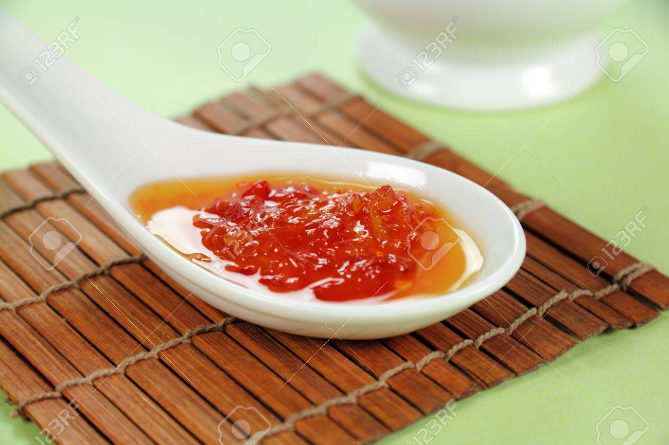Sweet chilli sauce in a spoon ready to serve. - 8862618
